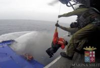 A passenger is airlifted to safety from the deck of the Norman Atlantic. (Reuters)