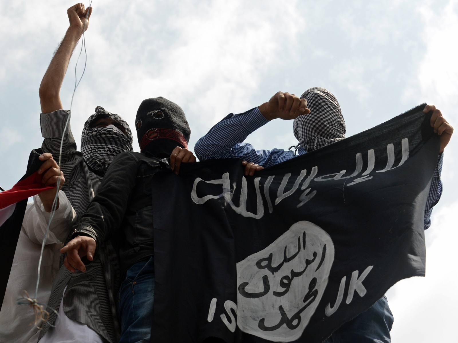 Protesters in Kashmir hold aloft the Isis flag, in recent protests against Israel's bombardment of Gaza. (Getty)
