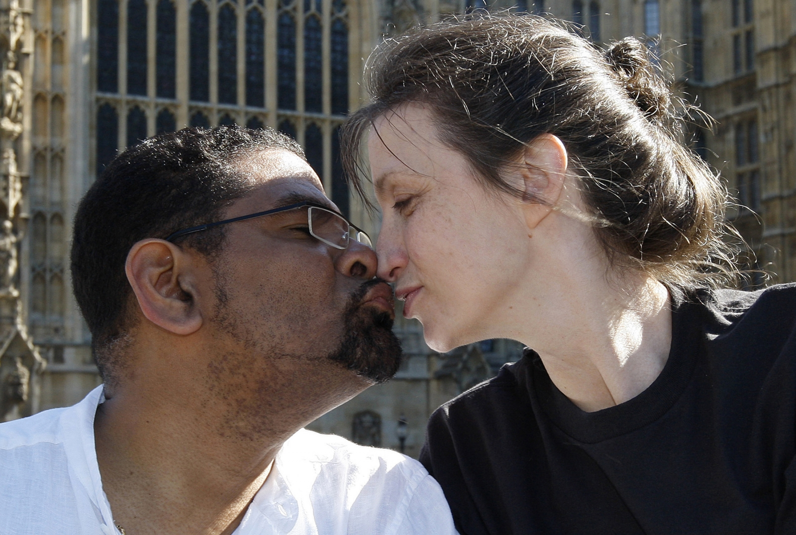 Multiple sclerosis sufferer Debbie Purdy [R] with her husband Omar Puente outside the House of Lords