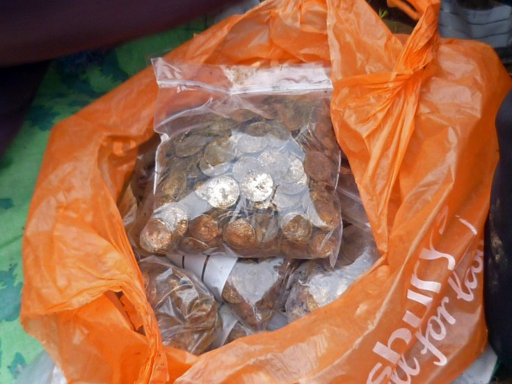 A total of 5,251 (and a half) silver Anglo Saxon coins were found. 500-600 coins were placed by the excavators into each polygrip bag