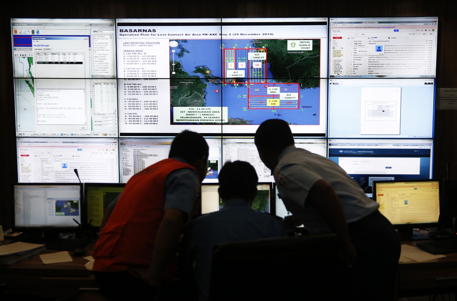 Authorities monitor progress in the search for AirAsia Flight QZ8501 in the Mission Control Center inside the National Search and Rescue Agency in Jakarta