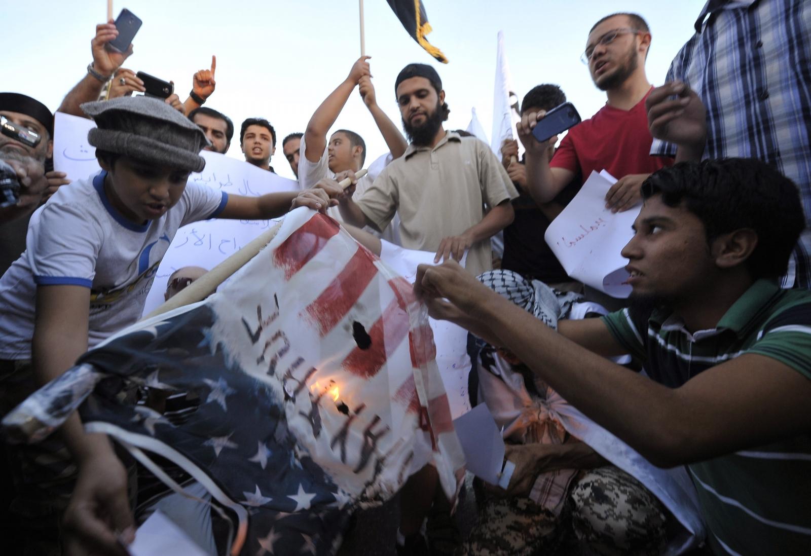 Libyan protesters burn American flag over al-Libi's arrest