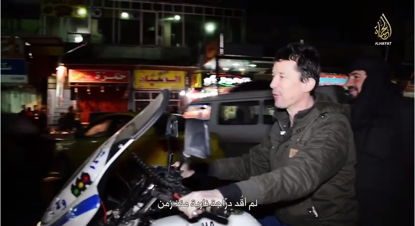 Cantlie on a police motorbike