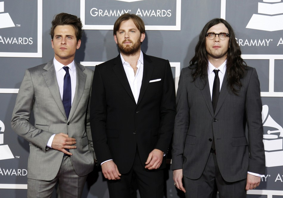 Rock band Kings of Leon pose on arrival at the 53rd annual Grammy Awards in Los Angeles, California