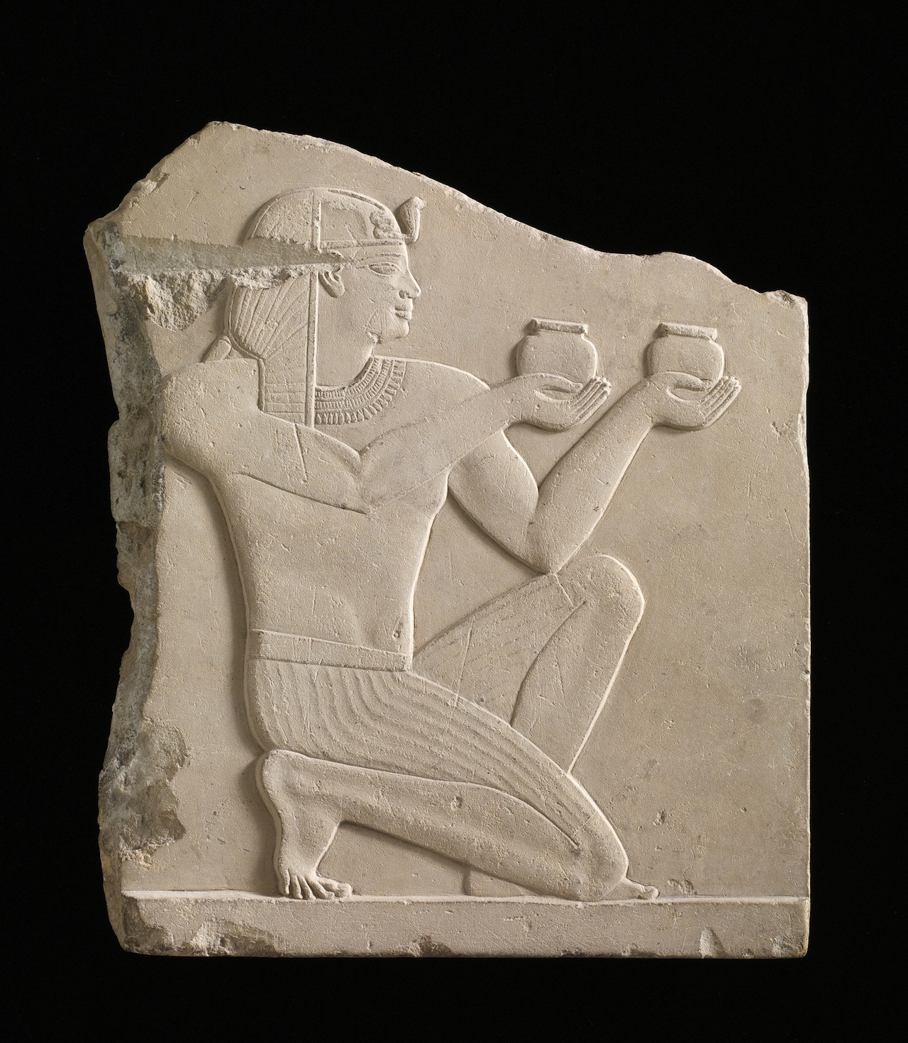 A plaque depicting a king offering wine, Egypt, possibly Ptolemaic dynasty, 305–30 BCE