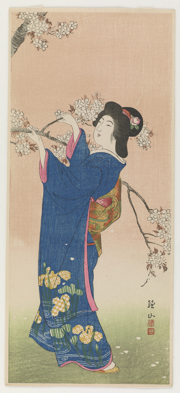 Woman and flowering cherry branch