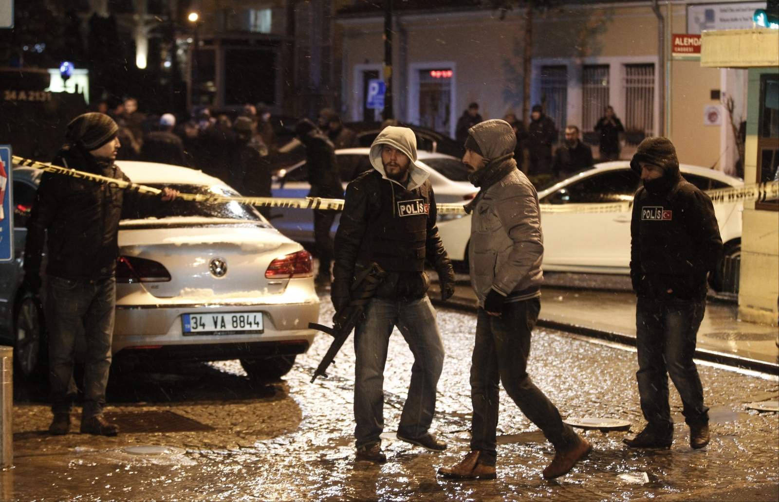 Police officers stand guard at the scene of a bomb blast in Istanbul