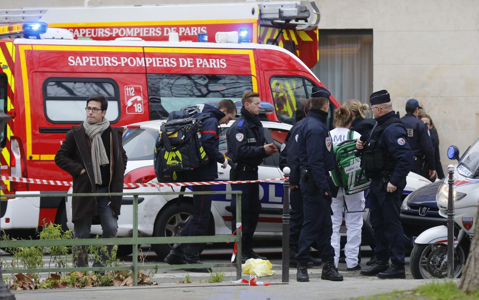 12 dead after Mohammed satirists Charlie Hebdo rocked by shooting