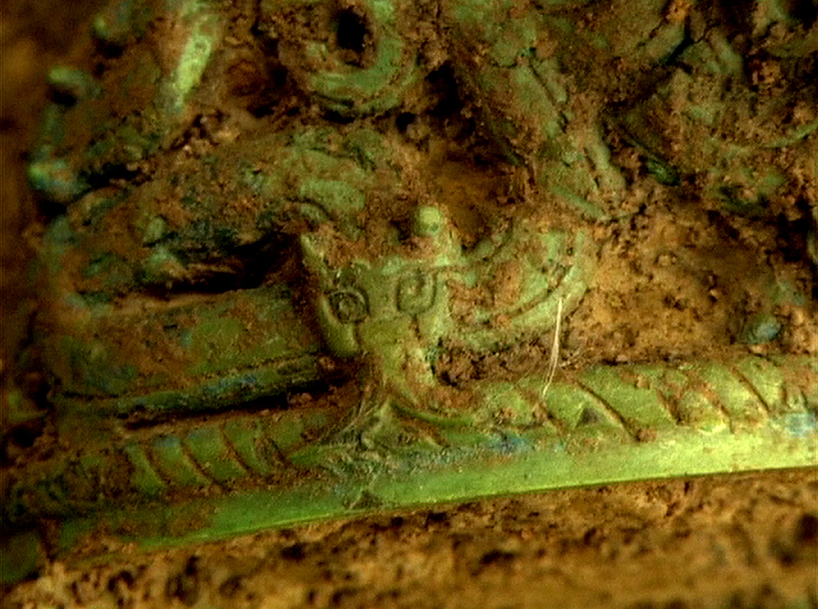 Close-up of the dragon on the pottery container unearthed from the tombs