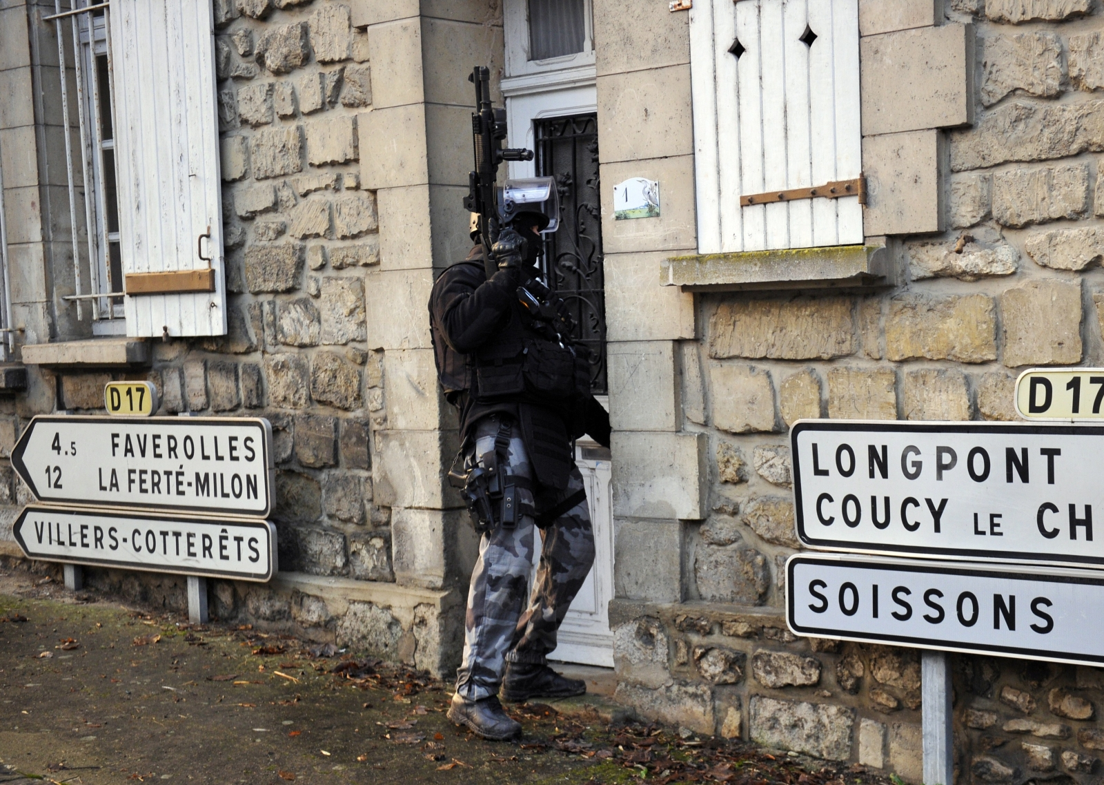 Members of the French police special force GIPN opens a door in Corcy, northern France