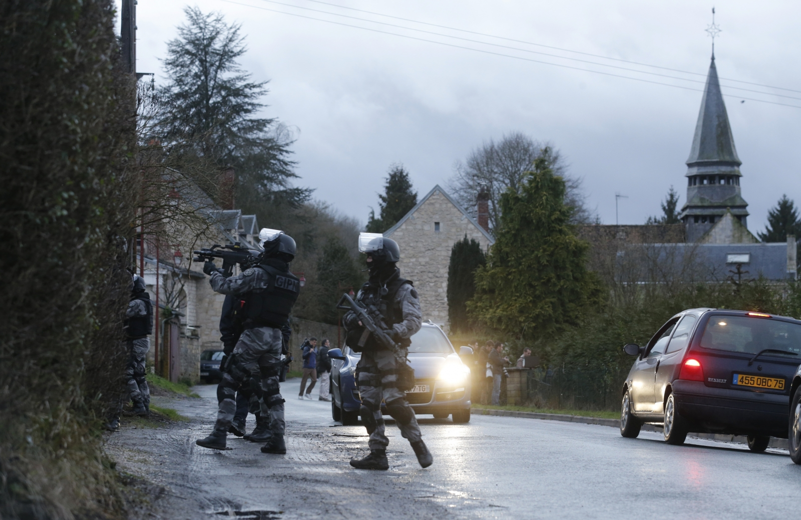 Charlie Hebdo Paris shooting: Shots fired and 'hostages taken' in Kouachi brothers manhunt
