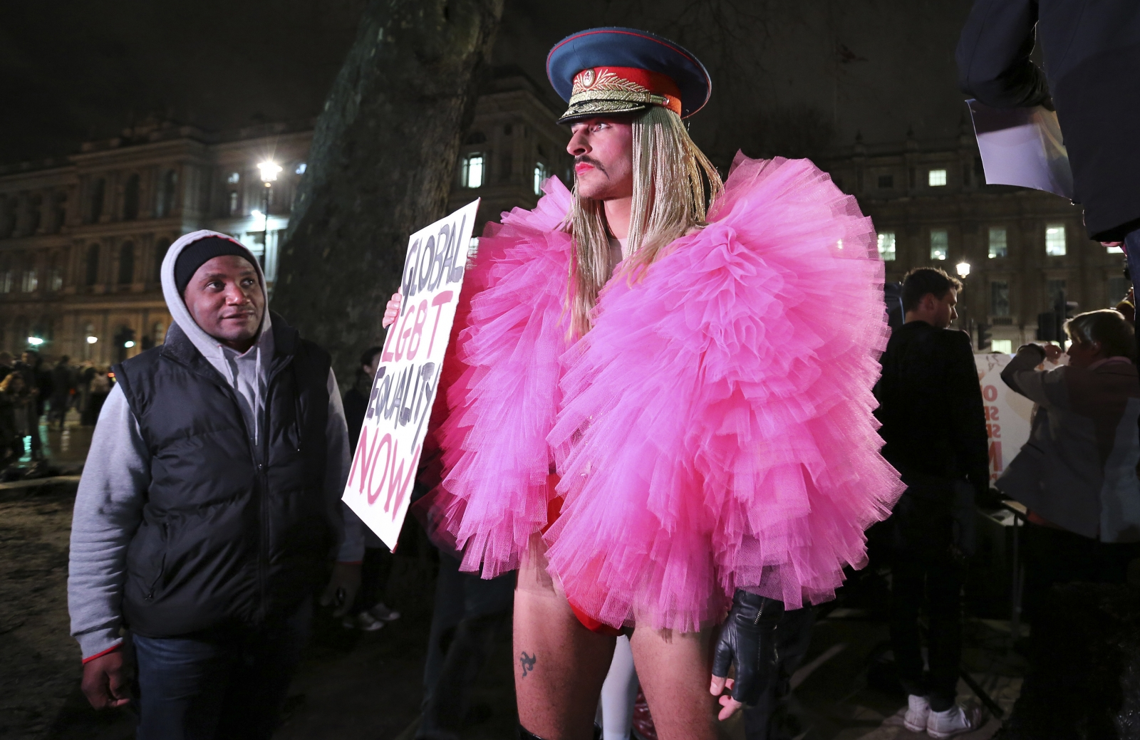 A gay rights protester rallies against Russia's anti-gay stance outside Downing Street, central London