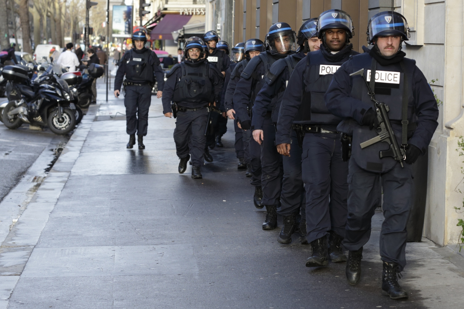 French riot police patrol ahead of the unity rally in central Paris.