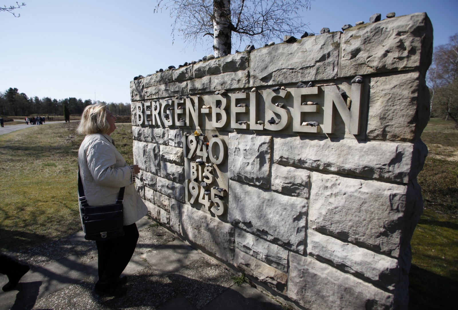 Susan Schwartz, one of the first children born in the Bergen-Belsen Displaced Persons Camp, visits the concentration camp Memorial