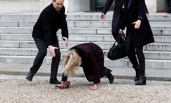 Danish Prime Minister Helle Thorning-Schmidt (C) took an unfortunate tumble as she tripped up on the stairs at the Elysee Palace after attending a Unity rally.