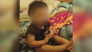 Indiana couple arrested after video shows handgun in toddler's mouth