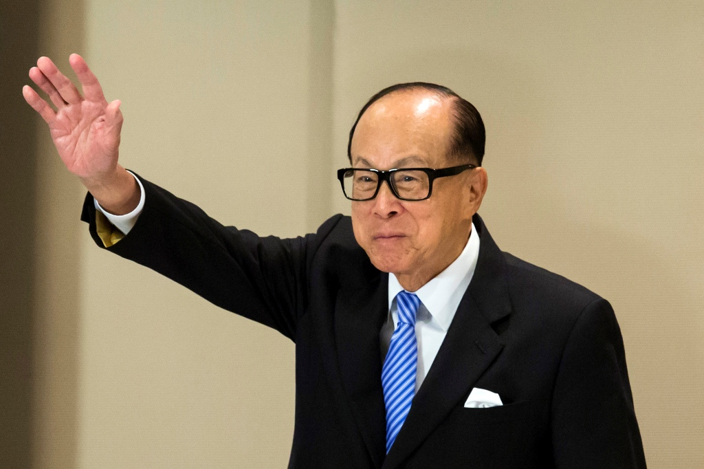 Shares in billionaire Li Ka-shing's firms surge on re-structuring plan