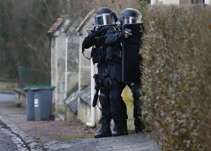 Members of the French GIPN intervention police forces search a neighbourhood in Longpont, northeast of Paris