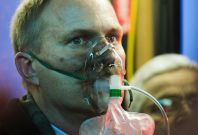 A smoke inhalation victim receives oxygen after passengers on the Metro service were injured
