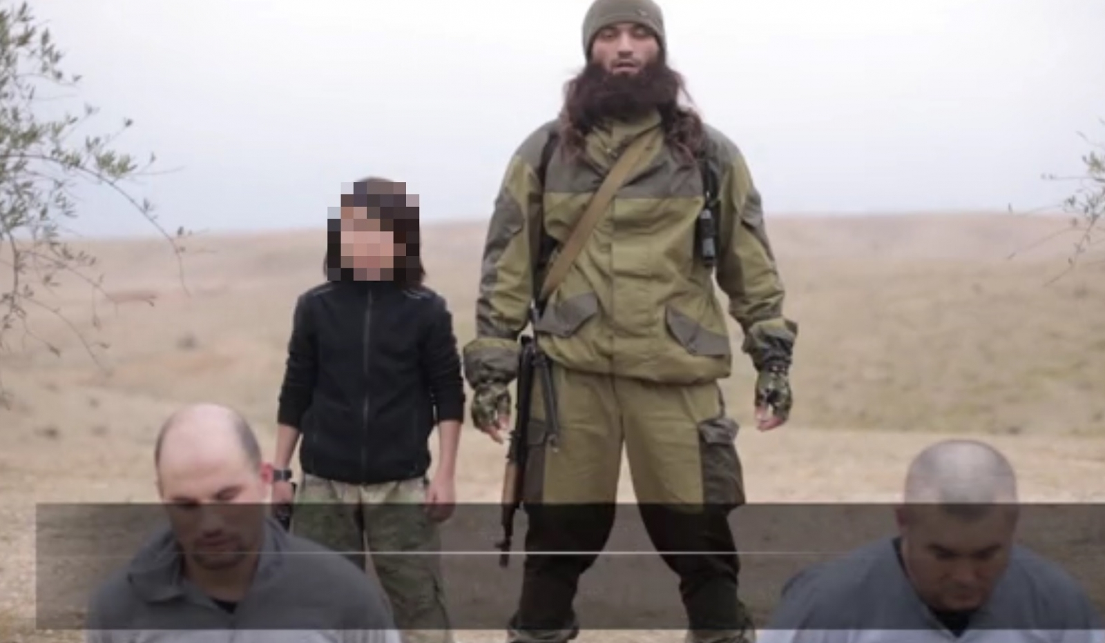 Isis most shocking execution video: Small boy executes two 'Russian spies' with pistol