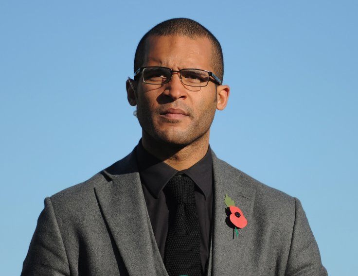 Former footballer Clarke Carlisle has woken up in hospital from his lorry crash injuries
