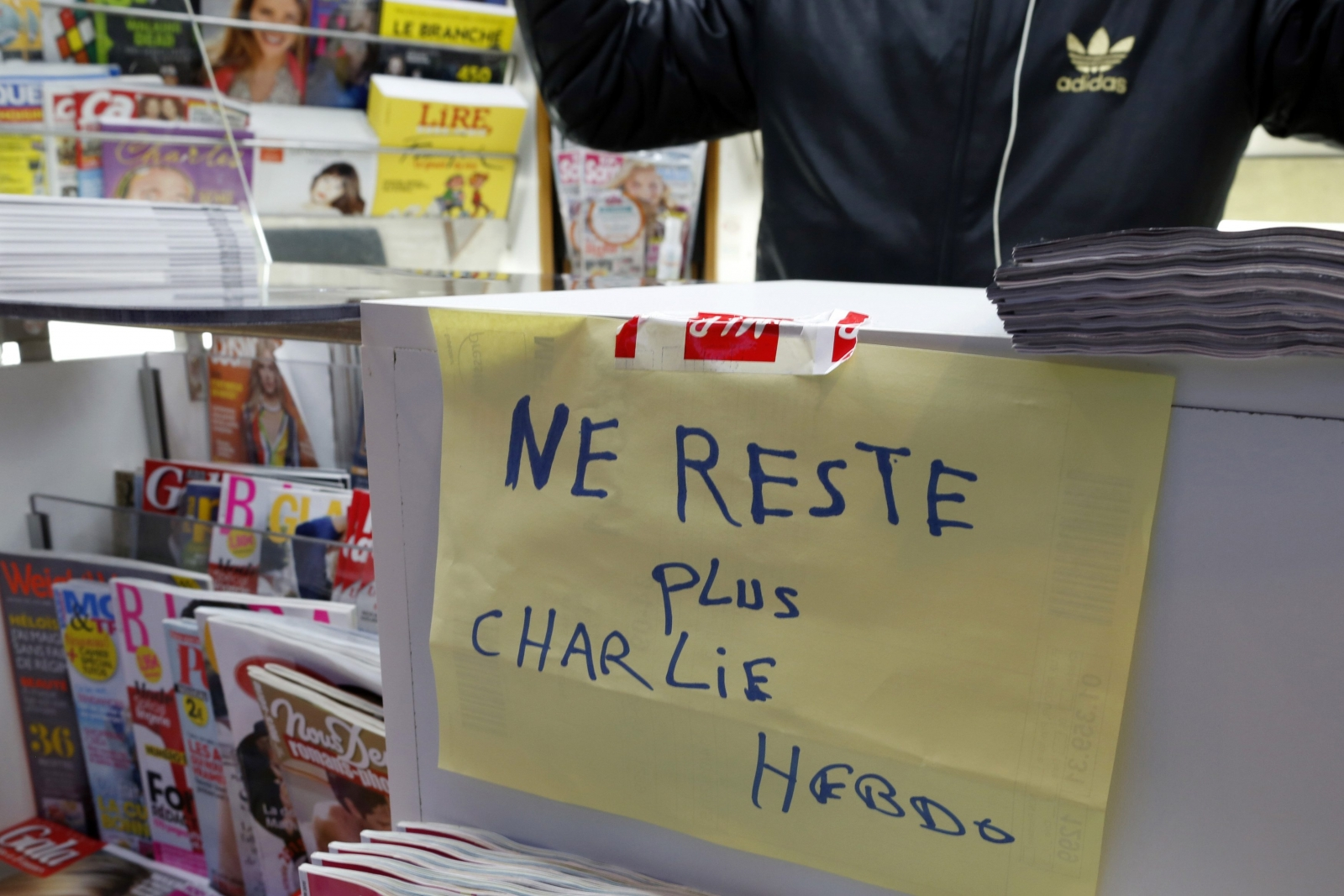 Parisians flock to buy new issue of Charlie Hebdo