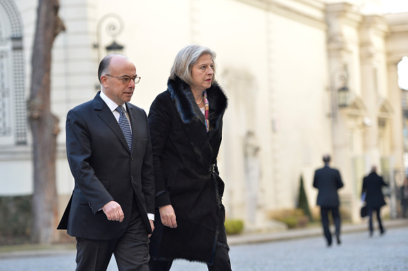 Bernard Cazeneuve (L), French Minister of Interior welcomes Theresa May