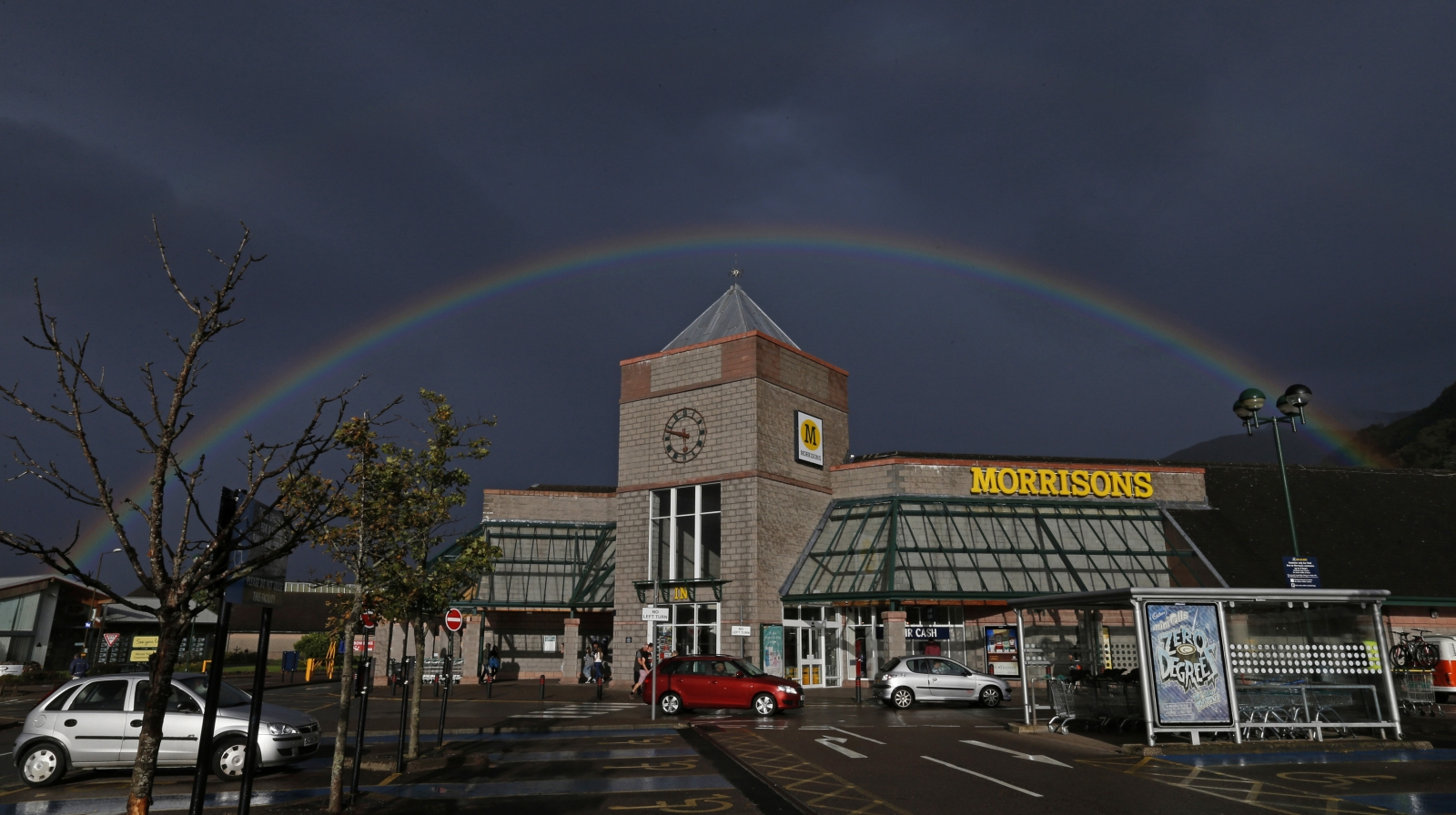 A rainbow is seen over Morrisons supermarket in Fort William, Scotland August 31, 2014