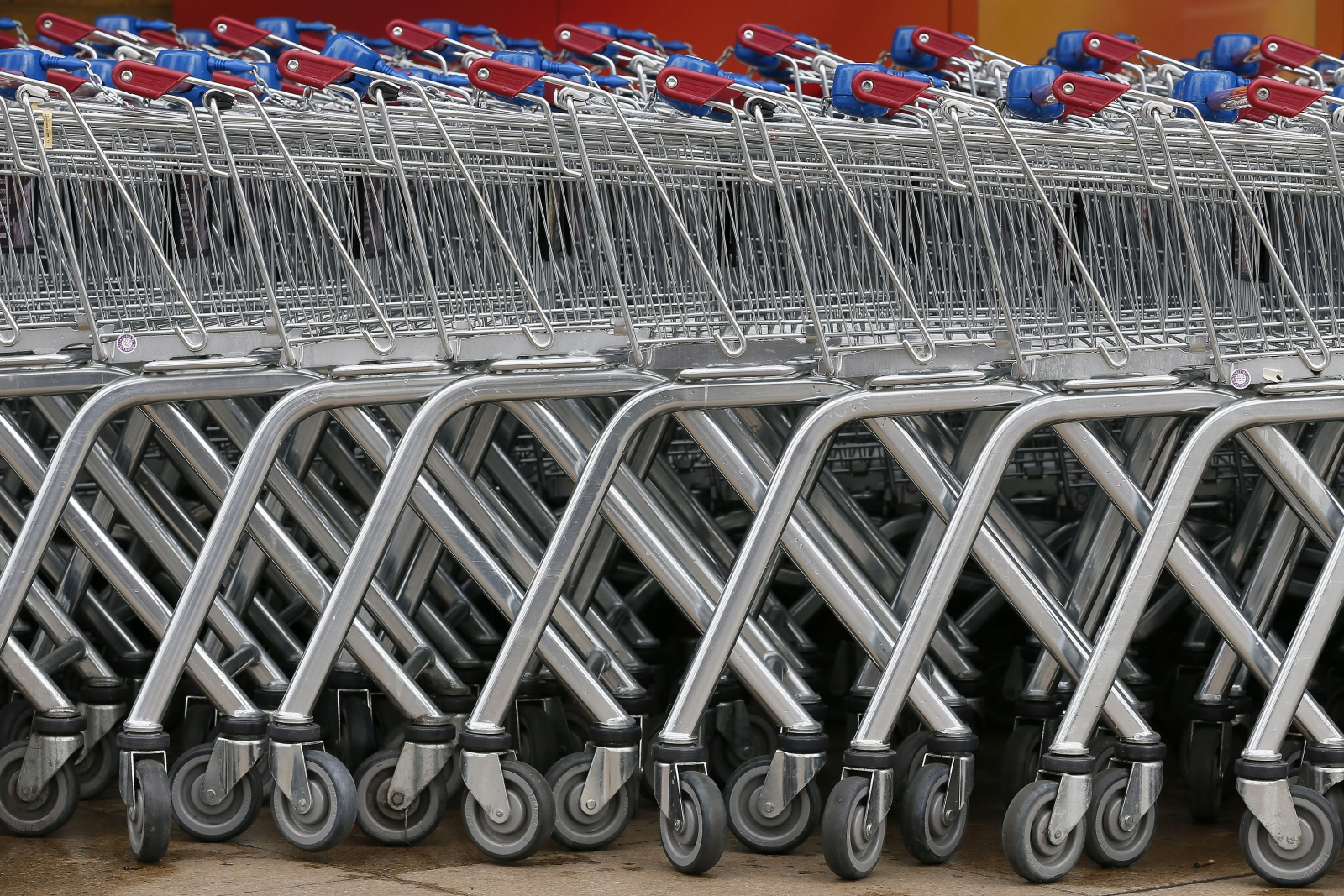 Shopping trolleys are seen parked at a Sainsbury's store in London May 8, 2013.