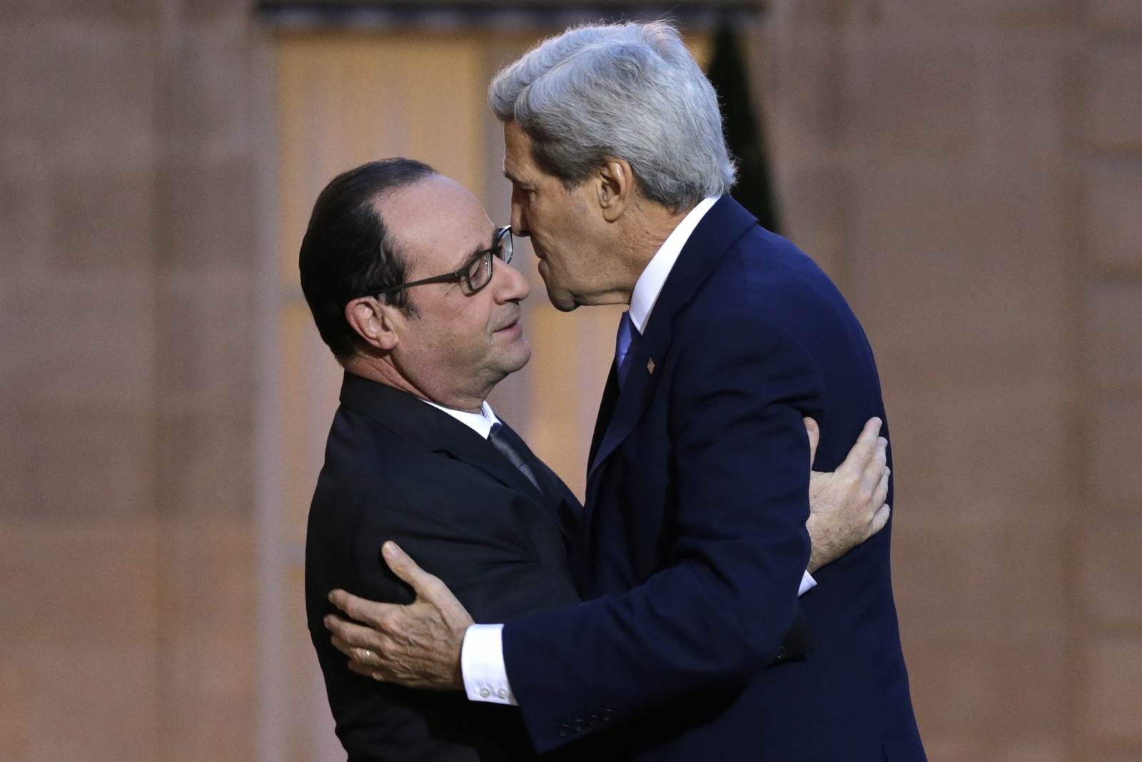 French President Francois Hollande (L) welcomes U.S. Secretary of State John Kerry