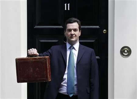 Chancellor George Osborne holds Gladstone's old Budget box for the cameras outside 11 Downing Street