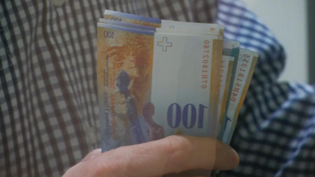 People rush to cash in as Swiss franc soars
