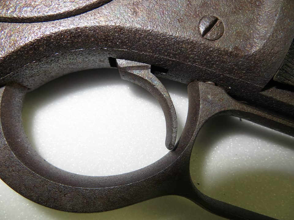The rusted trigger of the Winchester Model 1873
