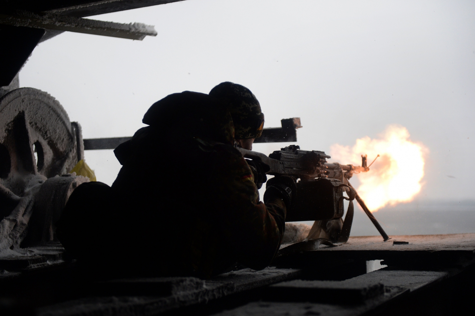 A Ukrainian volunteer fighter fires on a rebel position in Donetsk (Getty)