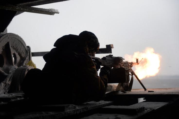 A Ukrainian volunteer fighter fires on a rebel position in Donetsk (Getty)