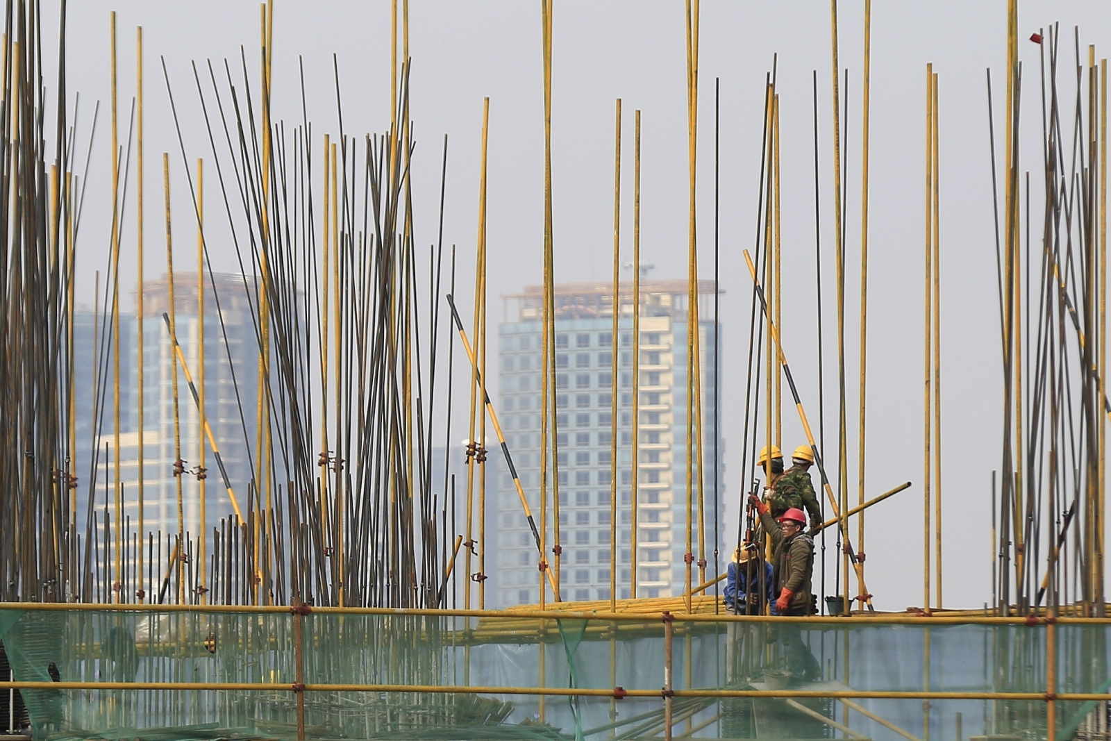 China's economy expands at 7.4% in 2014, slowest pace in 24 years