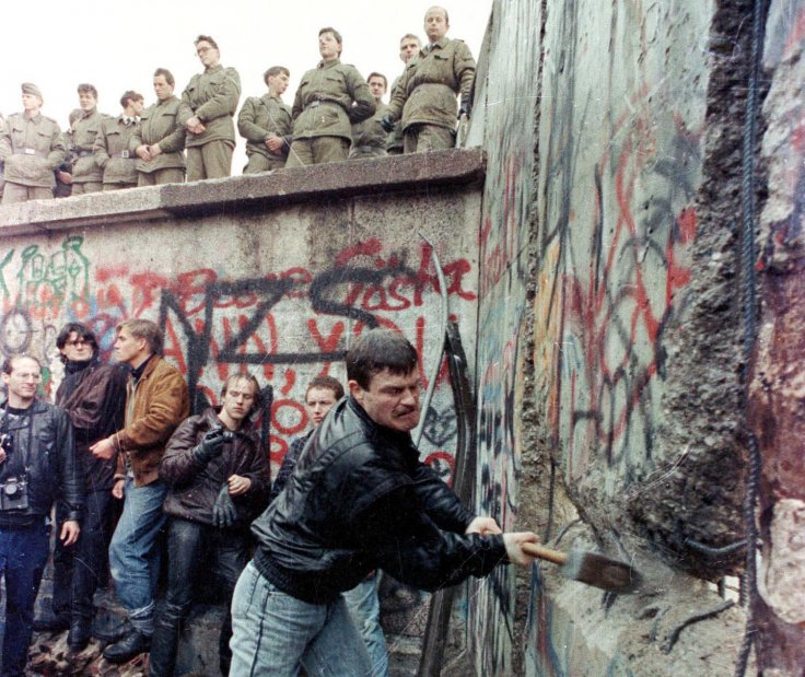 Activists destroy the Berlin Wall, dividing East and West Germany in 1989. (Reuters)