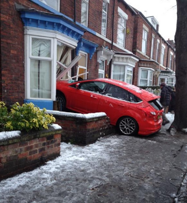 car crashes into home in Sheffield