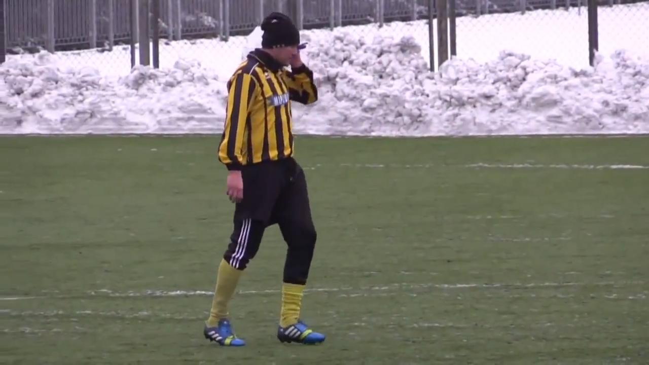 Ukrainian footballer Oleh Makarov answers mobile phone during match
