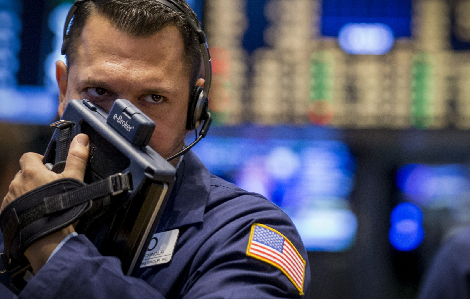 A trader works on the floor of the New York Stock Exchange August 15, 2014.