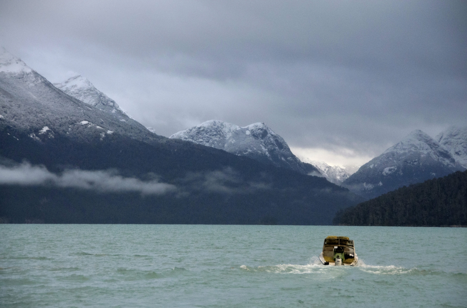 A boat travels on the Nahuel Huapi Lake in Argentina's mountain