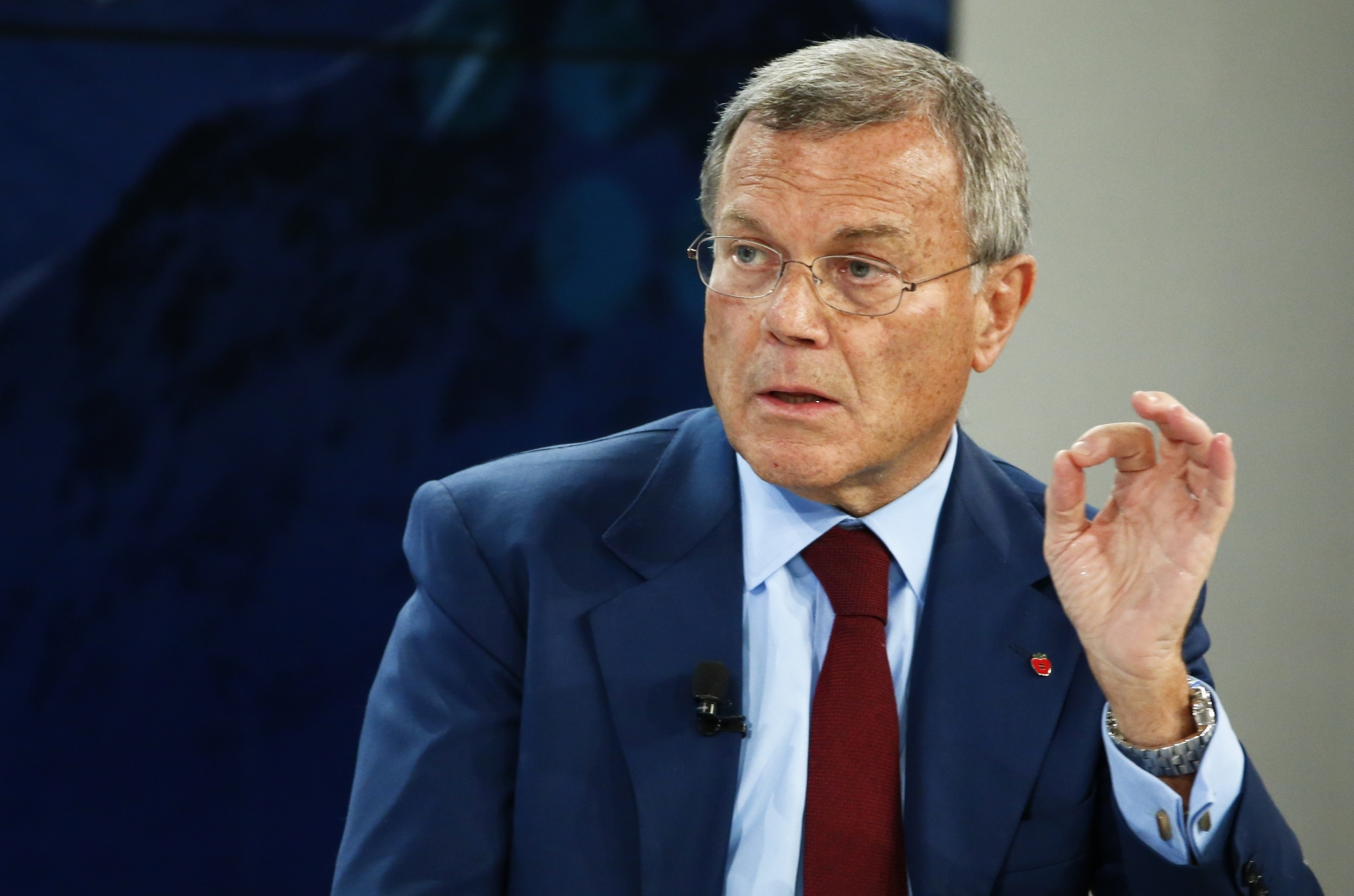 Sir Martin Sorrell, Chief Executive Officer of WPP, gestures during the session 'The BBC World Debate: A Richer World, but for Whom?' in the Swiss mountain resort of Davos January 23, 2015.