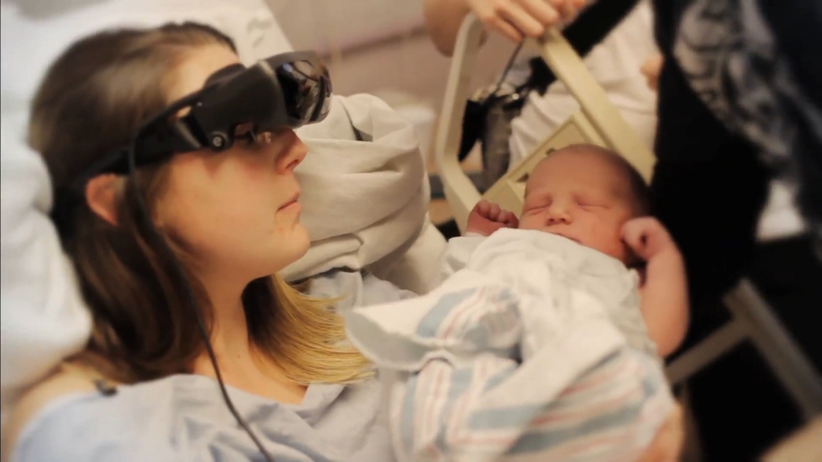 Blind woman sees her new baby for first time with special eyewear