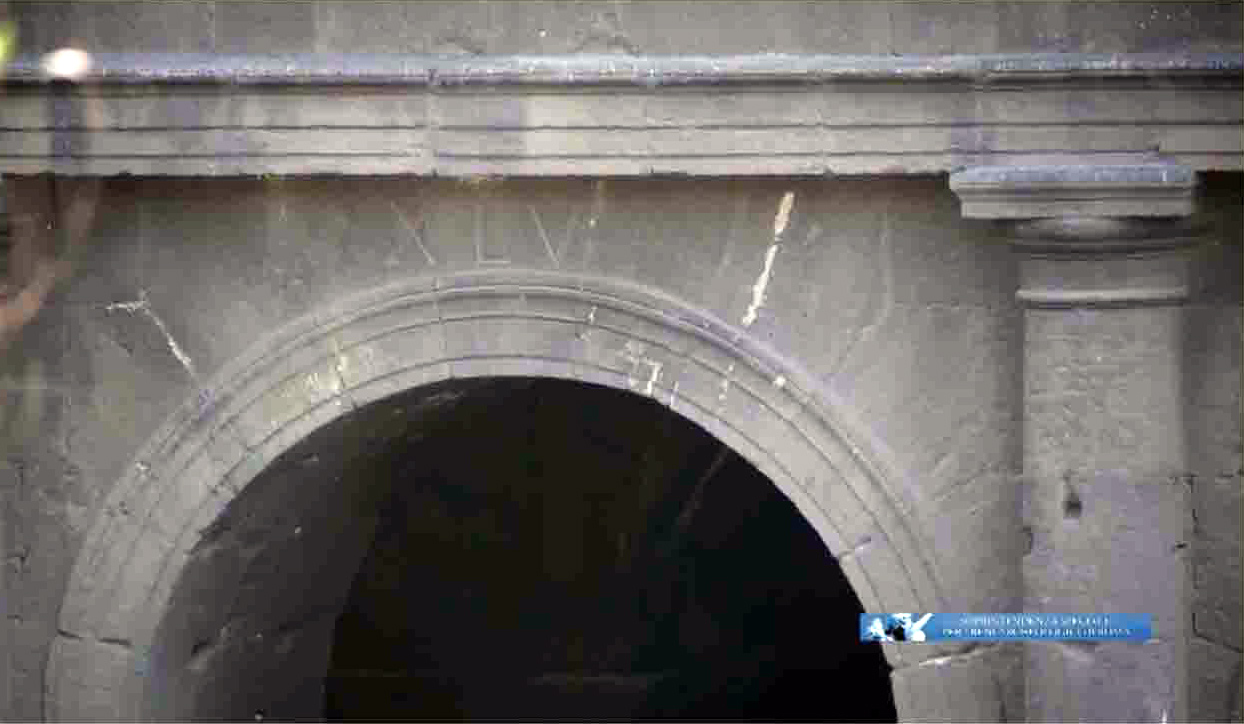 One of the arches in the Colosseum engraved with Roman numerals
