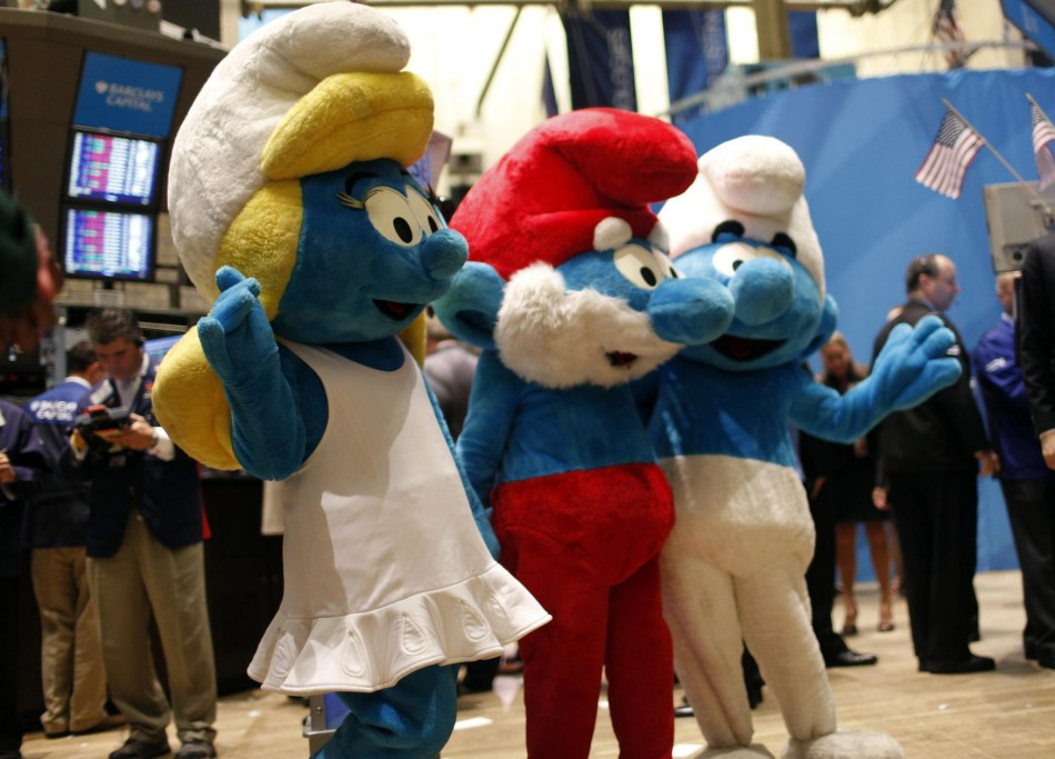 "Costumed ""Smurfs"" characters wave on the main trading floor of the New York Stock Exchange."