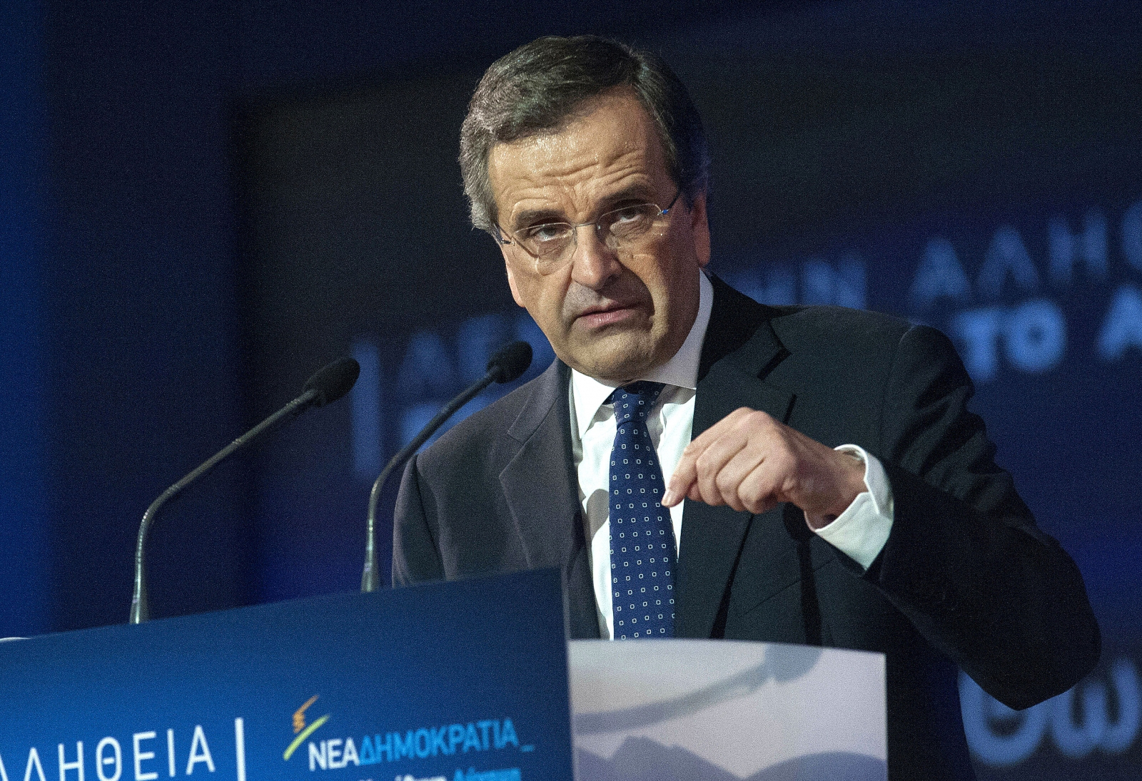 Greek Prime Minister and leader of the conservative New Democracy party Antonis Samaras addresses supporters during an election rally