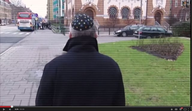 Still from the film, showing a reporter being attacked and subjected to antisemitic abuse while taking part in a TV experiment testing attitudes to Jews in malmo, Sweden.