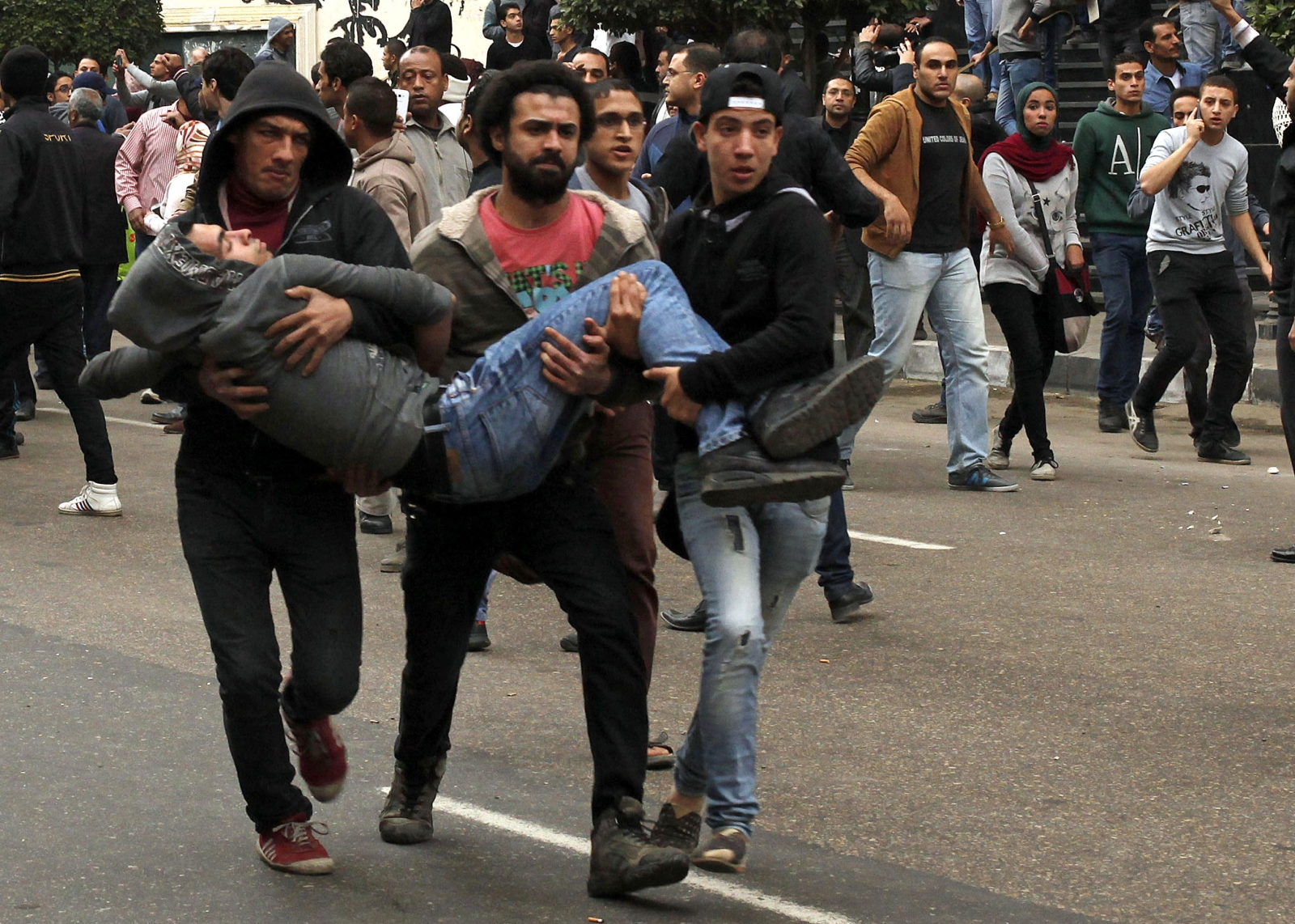Anti-goverment protesters help an injured demonstrator in Cairo. (Reuters)