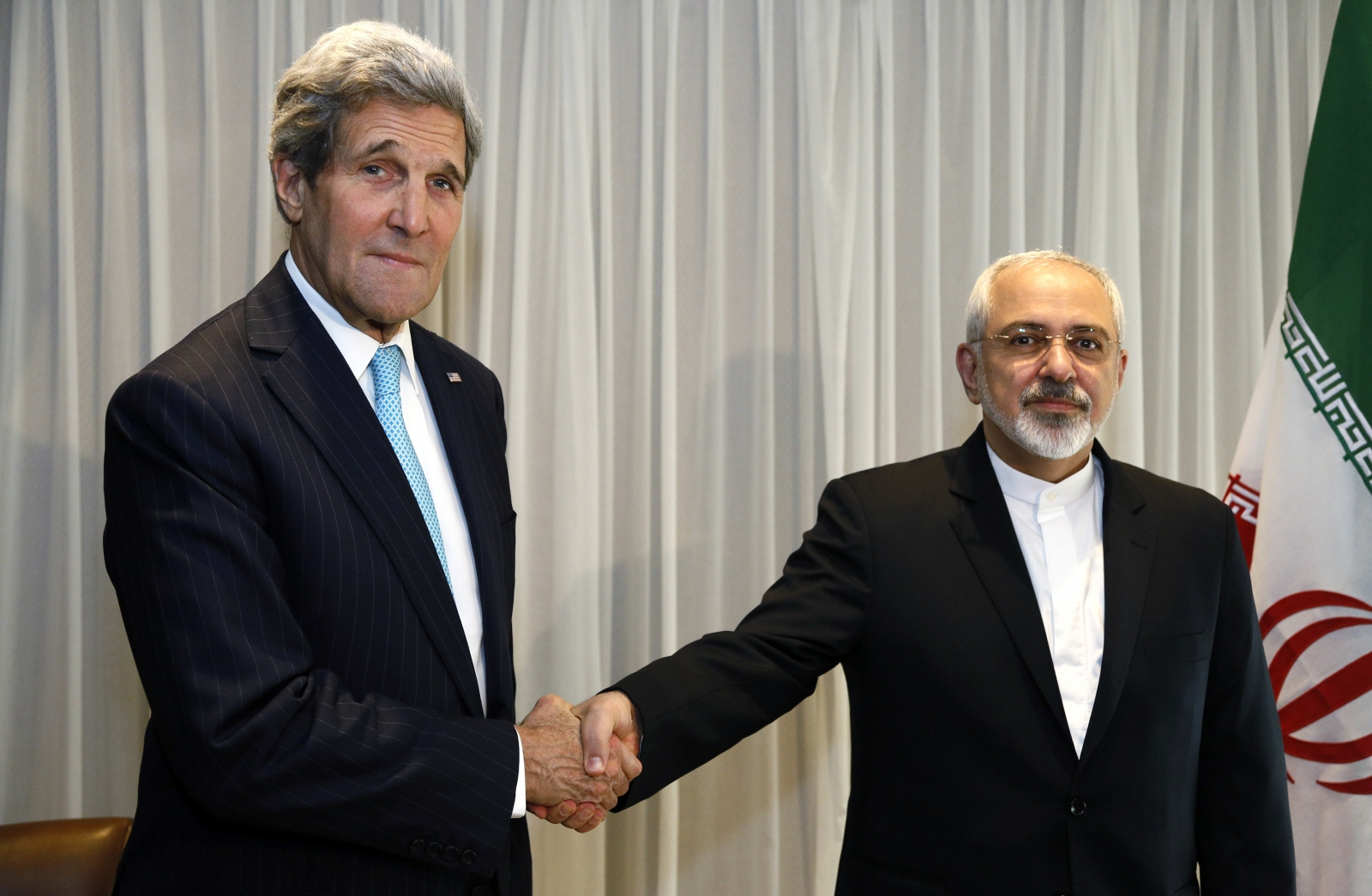 Iranian foreign minister summoned for walking with John Kerry