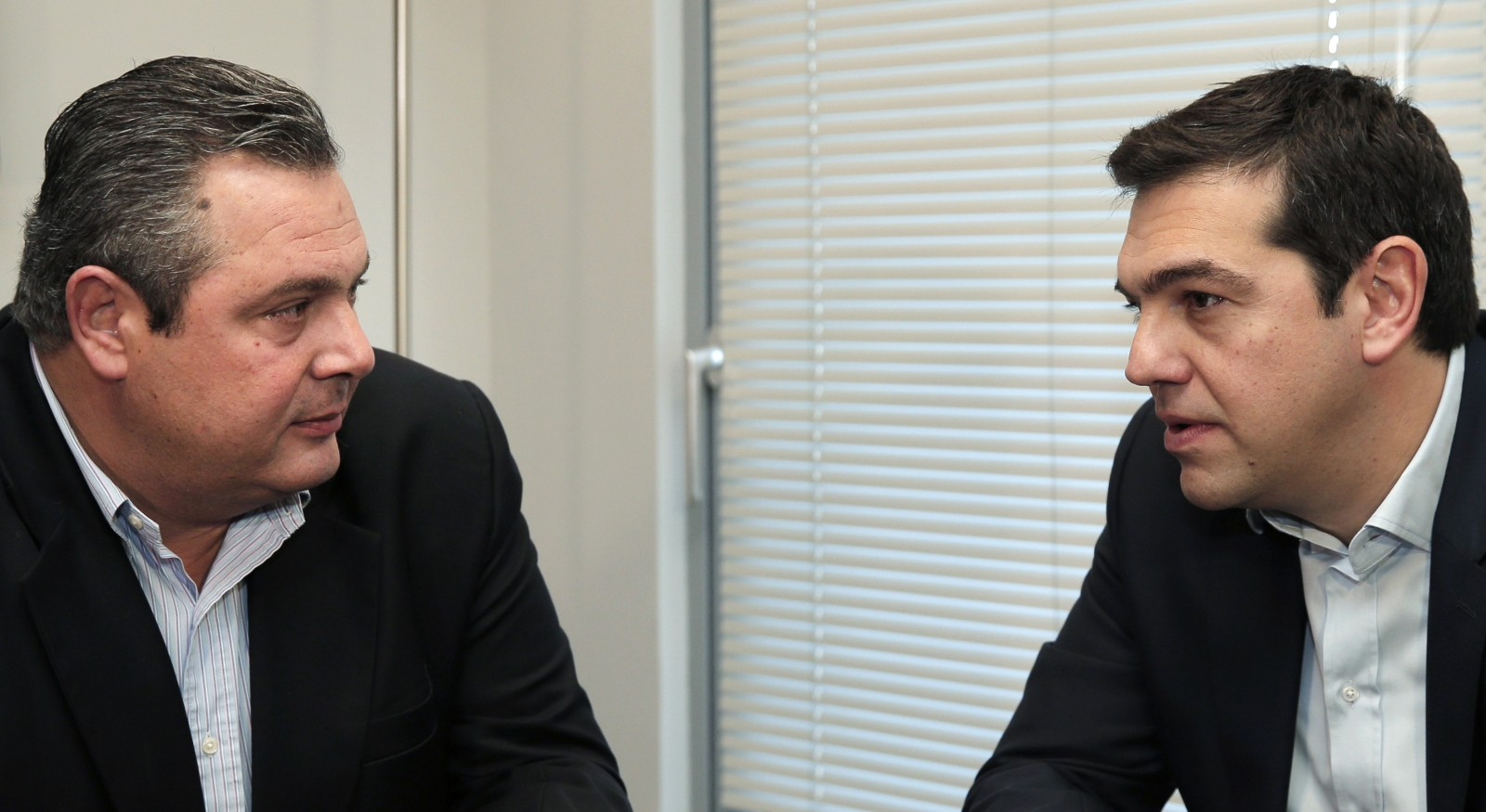 Head of radical leftist Syriza party Alexis Tsipras (R) meets with leader of right-wing, anti-bailout Independent Greeks party Panos Kammenos